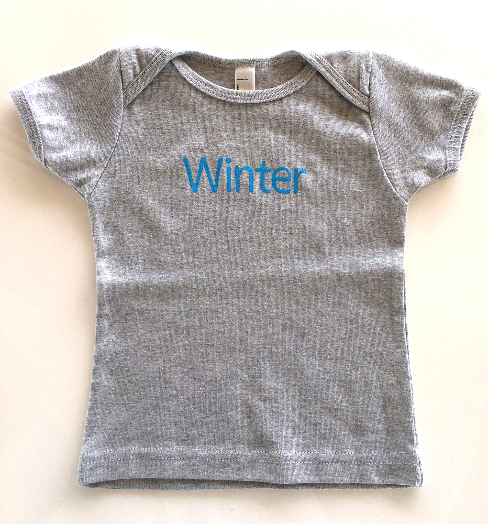 Baby winter on gray