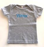Baby winter on gray
