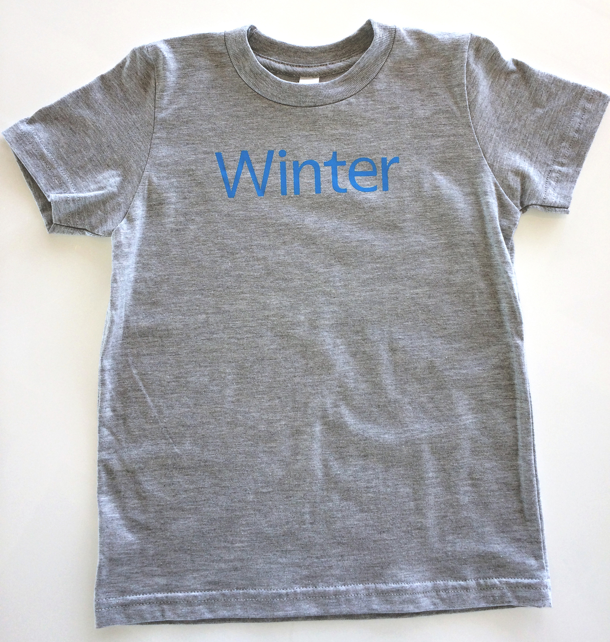 Toddler winter on gray